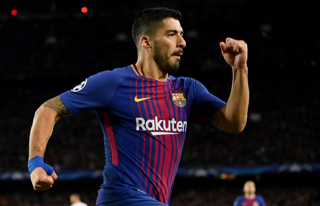 BARCELONA, SPAIN - APRIL 04: Luis Suarez of Barcelona celebrates after scoring his sides fourth goal during the UEFA Champions League Quarter Final Leg One match between FC Barcelona and AS Roma at Camp Nou on April 4, 2018 in Barcelona, Spain. (Photo by Stuart Franklin/Getty Images)