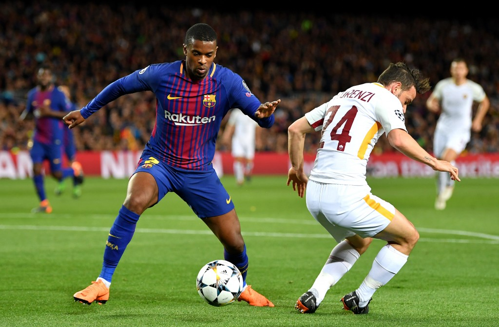 BARCELONA, SPAIN - APRIL 04: Nelson Semedo of Barcelona is challenged by Patrik Schick of AS Roma during the UEFA Champions League Quarter Final Leg One match between FC Barcelona and AS Roma at Camp Nou on April 4, 2018 in Barcelona, Spain. (Photo by Stuart Franklin/Getty Images)