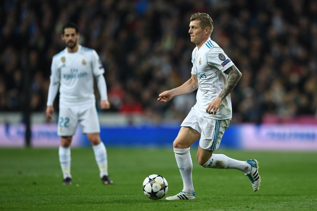 MADRID, SPAIN - APRIL 11: Toni Kroos of Real Madrid runs with the ball during the UEFA Champions League Quarter Final Second Leg match between Real Madrid and Juventus at Estadio Santiago Bernabeu on April 11, 2018 in Madrid, Spain. (Photo by David Ramos/Getty Images)