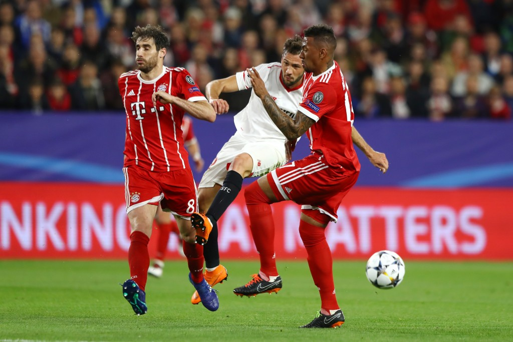 SEVILLE, SPAIN - APRIL 03: Javi Martinez of Bayern Muenchen and Jerome Boateng of Bayern Muenchen attempt to block Franco Vazquez of Sevilla shot during the UEFA Champions League Quarter Final Leg One match between Sevilla FC and Bayern Muenchen at Estadio Ramon Sanchez Pizjuan on April 3, 2018 in Seville, Spain. (Photo by Martin Rose/Bongarts/Getty Images)