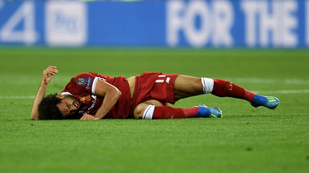 Mohamed Salah lies on the floor injured after a clash with Sergio Ramos. (Photo courtesy: AFP/Getty)