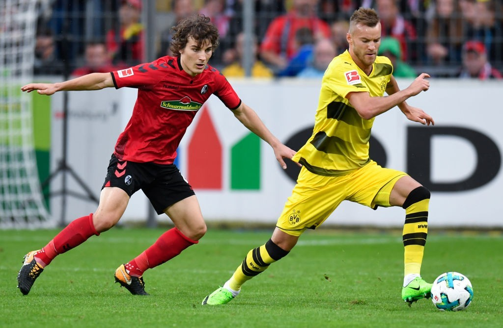 Is Caglar Soyuncu (L) Liverpool bound? (Photo by THOMAS KIENZLE/AFP/Getty Images)
