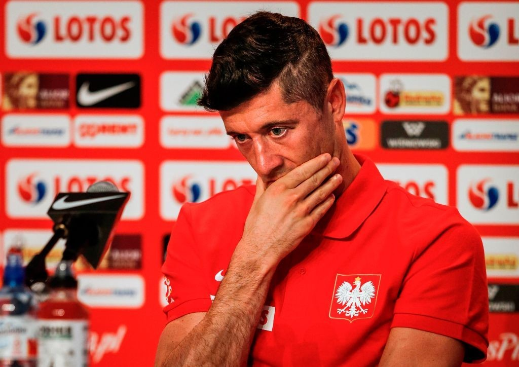 Can Lewandowski inspire his team to a win? (Photo by ADRIAN DENNIS/AFP/Getty Images)