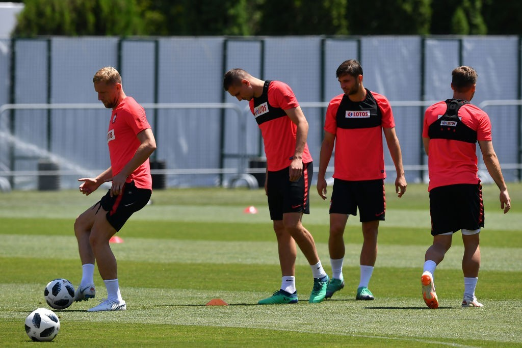 Fit again Kamil Glik (L) will solidify Poland's rearguard (Photo by NELSON ALMEIDA/AFP/Getty Images)