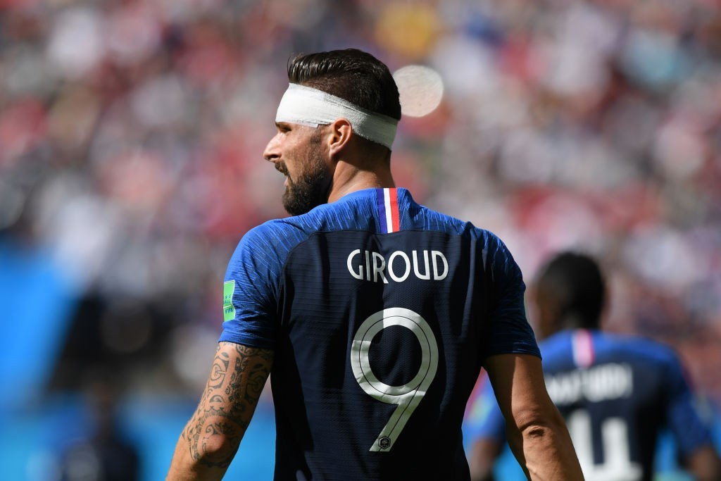 France strides into knockout stage, Mbappe makes history