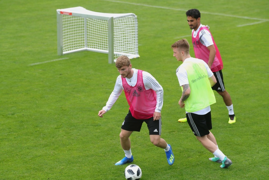 EPPAN, ITALY - MAY 24: Timo Werner (L), Marco Reus and Ilkay Guendogan play with the ball during a training session of the German national team at Sportanlage Rungg on day two of the Southern Tyrol Training Camp on May 24, 2018 in Eppan, Italy. (Photo by Alexander Hassenstein/Bongarts/Getty Images)