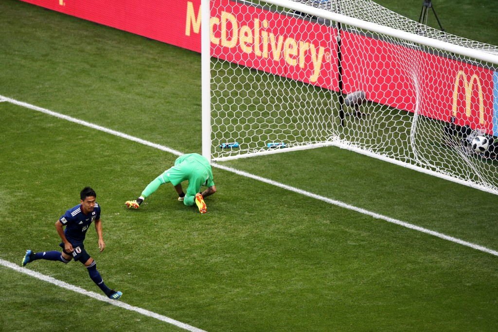 Kagawa was his usual self for Japan. (Picture Courtesy - AFP/Getty Images)