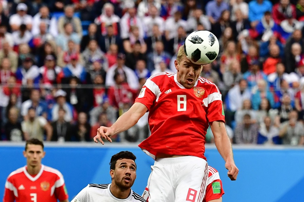 Uruguay lead 2-0 against 10-man Russia in Group A decider