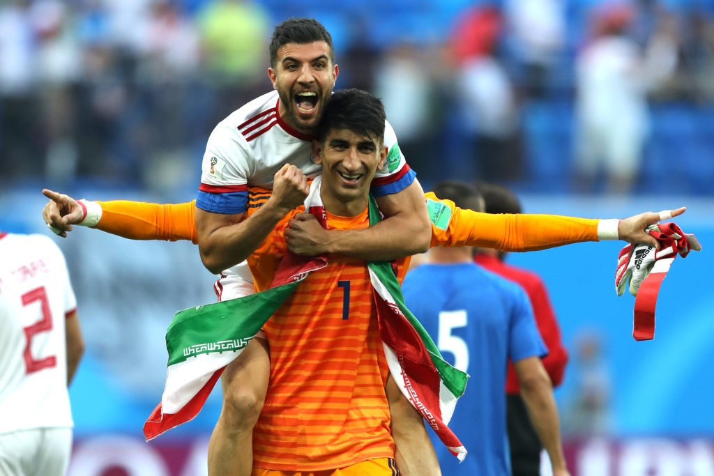 Alireza Beiranvand celebrates after Iran won their opening game of Group B. (Photo courtesy: AFP/Getty)