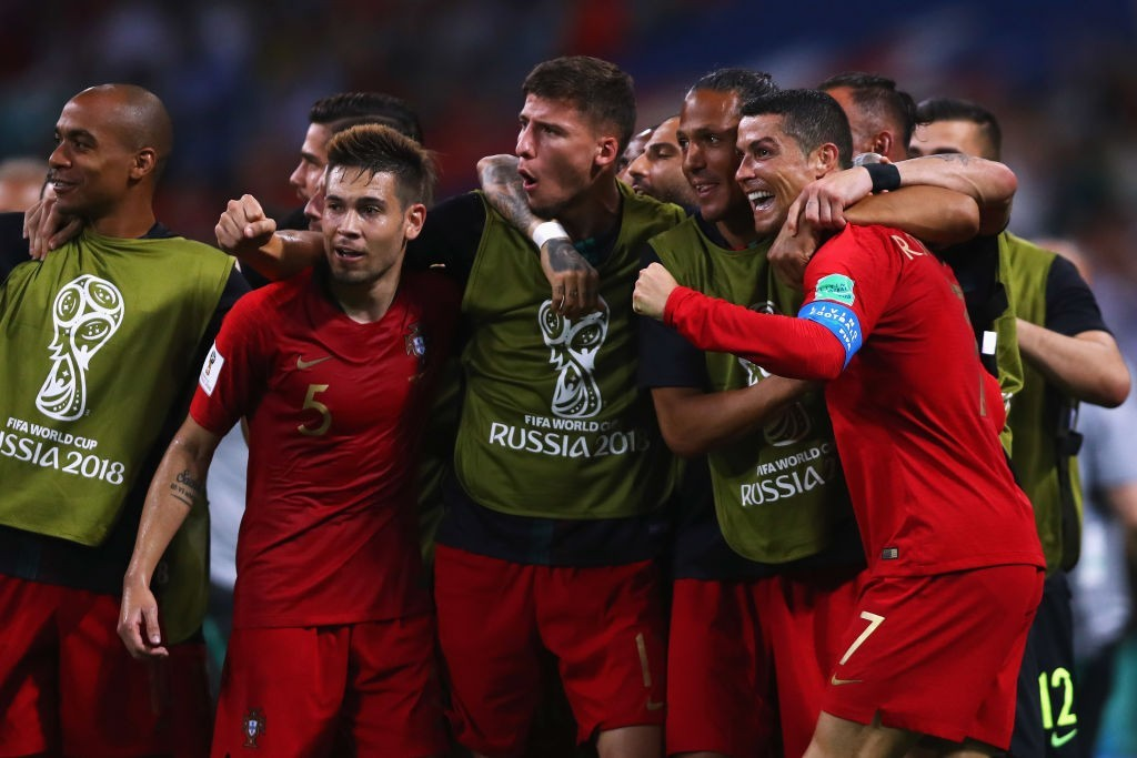 SOCHI, RUSSIA - JUNE 15: Cristiano Ronaldo of Portugal celebrates with team mates after scoring his team's second goal of the match during the 2018 FIFA World Cup Russia group B match between Portugal and Spain at Fisht Stadium on June 15, 2018 in Sochi, Russia. (Photo by Dean Mouhtaropoulos/Getty Images)