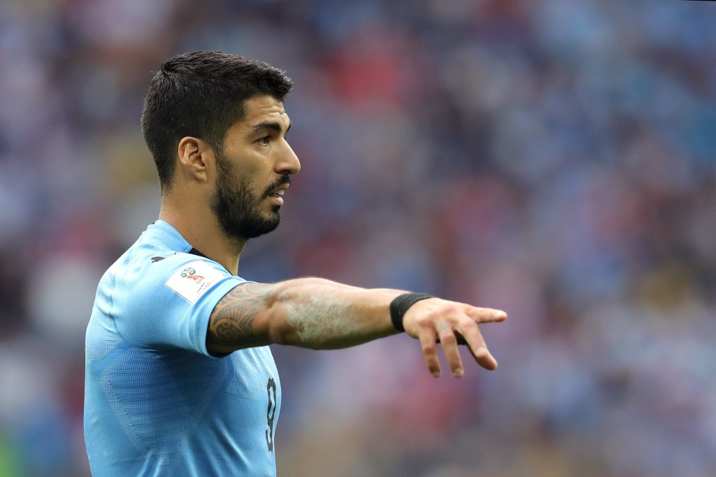 Suarez to stay! (Picture Courtesy - AFP/Getty Images)