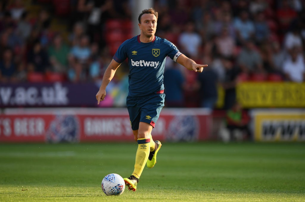 West Ham Captain, Mark Noble is set to miss the Arsenal clash with a back injury. (Photo courtesy: AFP/Getty)