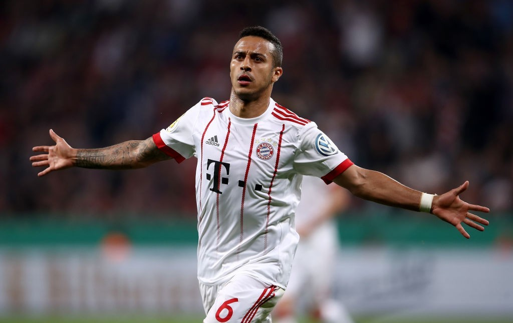 LEVERKUSEN, GERMANY - APRIL 17: Thiago of Bayern celebrates after he scores the 4th goal during the DFB Cup semi final match between Bayer 04 Leverkusen and Bayern Munchen at BayArena on April 17, 2018 in Leverkusen, Germany. (Photo by Alex Grimm/Bongarts/Getty Images)