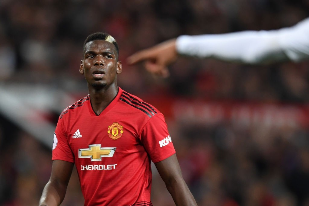 Pique says Man United's Pogba would be welcome at Barca