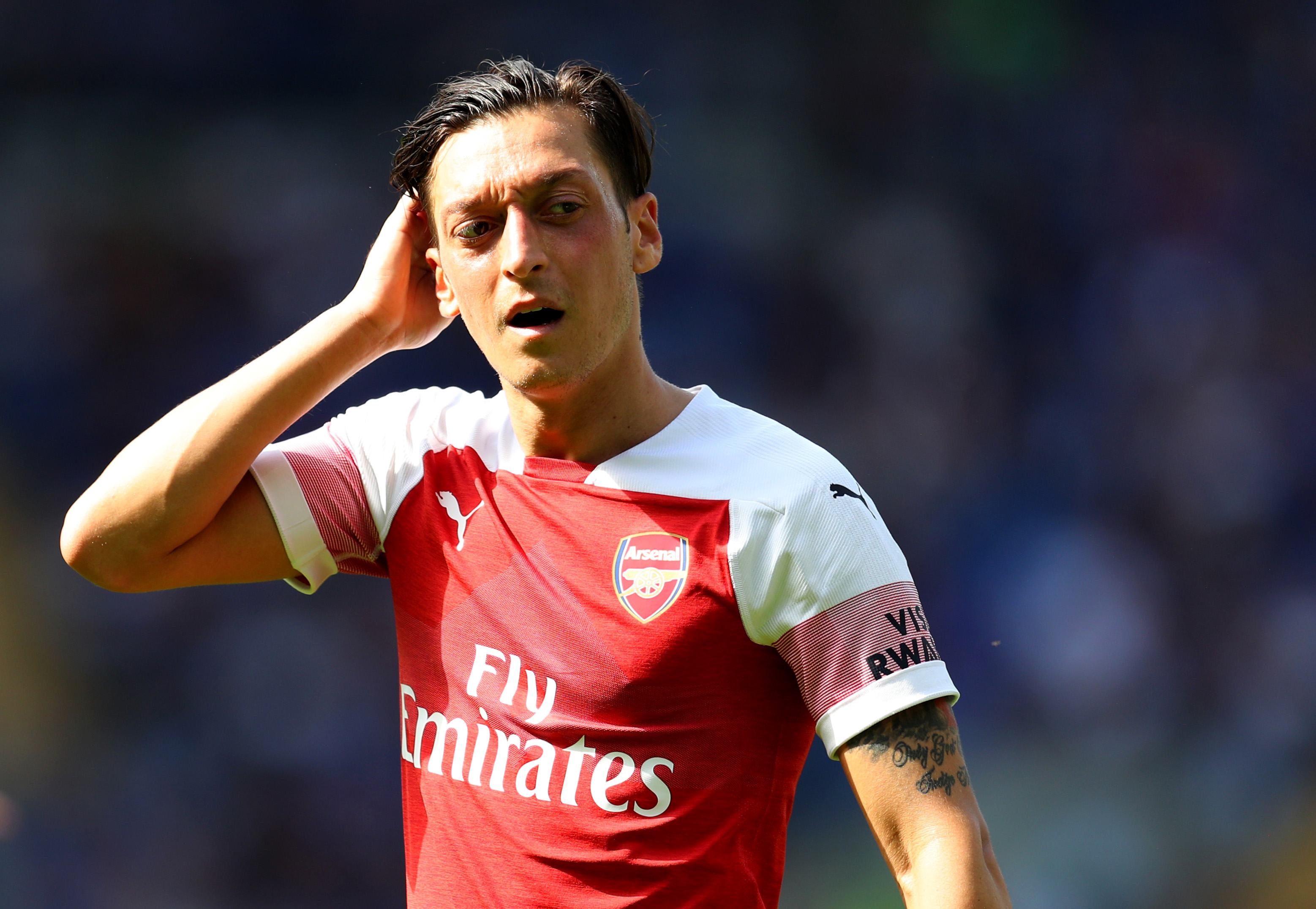 Ozil wants to stay with Arsenal and is prepared to fight for his place. (Photo courtesy: AFP/Getty)
