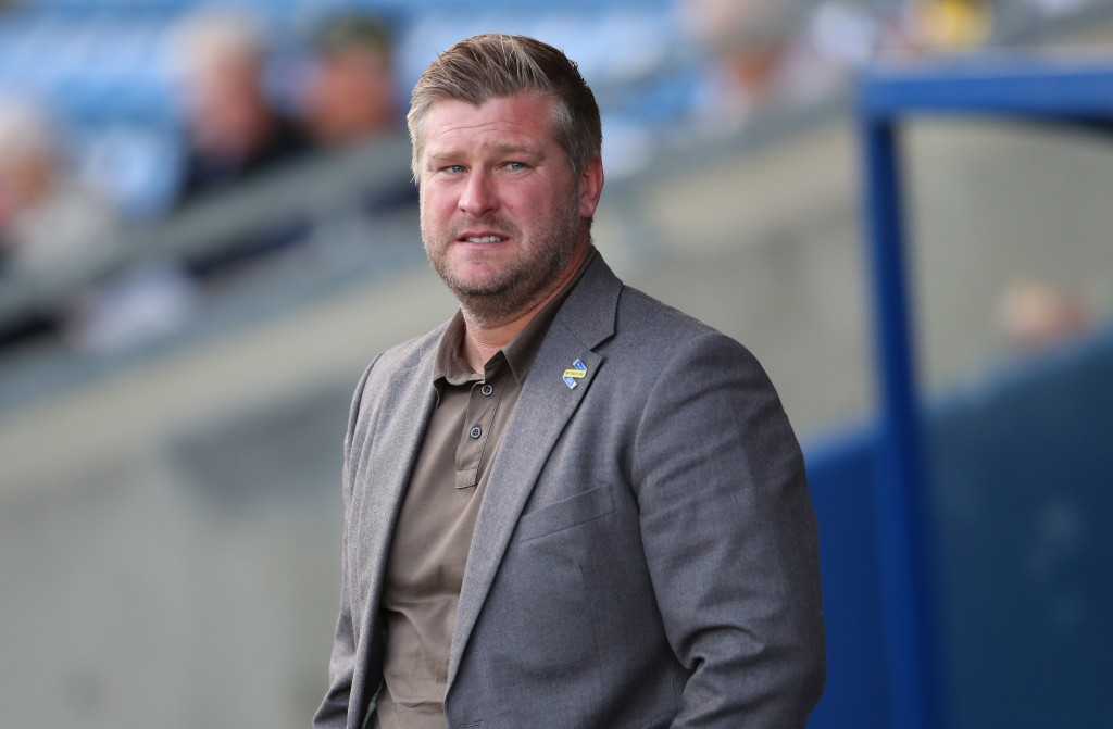 Can Karl Robinson & co. spring a surprise? (Photo courtesy - Catherine Ivill/Getty Images)