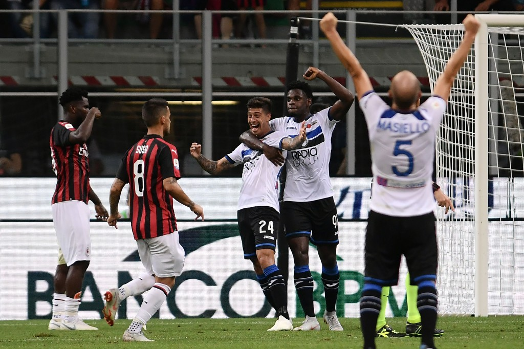 Rigoni (C) made Milan pay for their missed chances (Photo by MARCO BERTORELLO/AFP/Getty Images)
