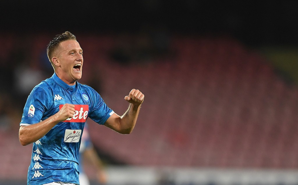 NAPLES, ITALY - AUGUST 25: Piotr Zielinski of SSC Napoli celebrates after scoring the 2-2 goal during the serie A match between SSC Napoli and AC Milan at Stadio San Paolo on August 25, 2018 in Naples, Italy. (Photo by Francesco Pecoraro/Getty Images)