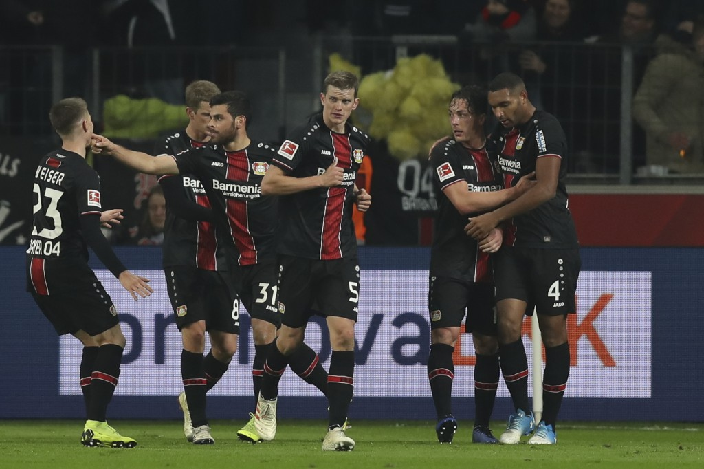 LEVERKUSEN, GERMANY - NOVEMBER 23: Kevin Volland #31 of Bayer Leverkusen celebrates with teammates after scoring his team's first goal during the Bundesliga match between Bayer 04 Leverkusen and VfB Stuttgart at BayArena on November 23, 2018 in Leverkusen, Germany. (Photo by Maja Hitij/Bongarts/Getty Images)