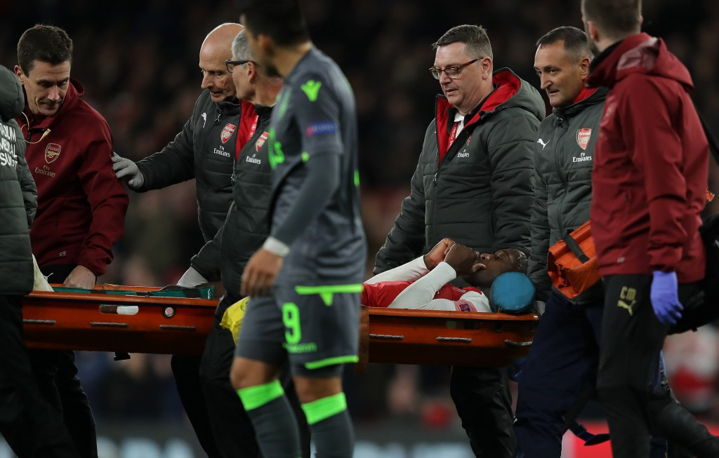 Unlucky Welbeck stretchered off the field (Photo by Richard Heathcote/Getty Images)