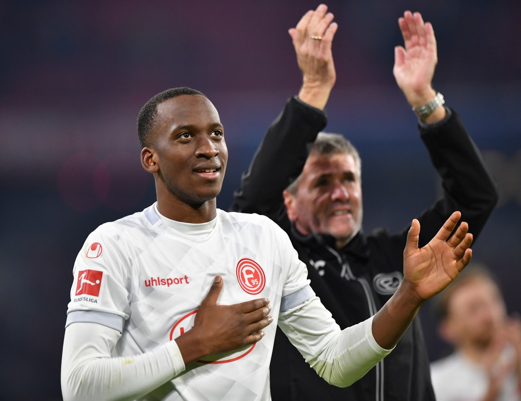 MUNICH, GERMANY - NOVEMBER 24: Dodi Lukebakio of Duesseldorf celebrates with fans after the Bundesliga match between FC Bayern Muenchen and Fortuna Duesseldorf at Allianz Arena on November 24, 2018 in Munich, Germany. (Photo by Sebastian Widmann/Bongarts/Getty Images)