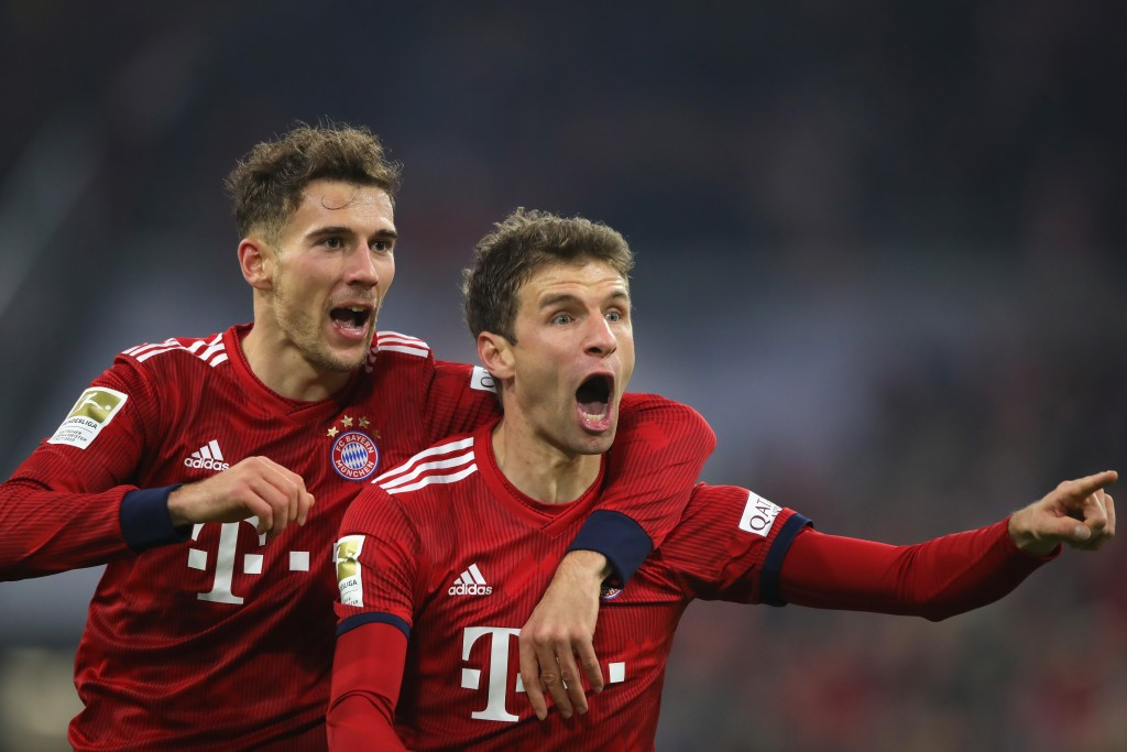 MUNICH, GERMANY - NOVEMBER 24: Thomas Mueller of Bayern Muenchen celebrates scoring the second team goal with his team mate Leon Goretzka during the Bundesliga match between FC Bayern Muenchen and Fortuna Duesseldorf at Allianz Arena on November 24, 2018 in Munich, Germany. (Photo by Alexander Hassenstein/Bongarts/Getty Images)