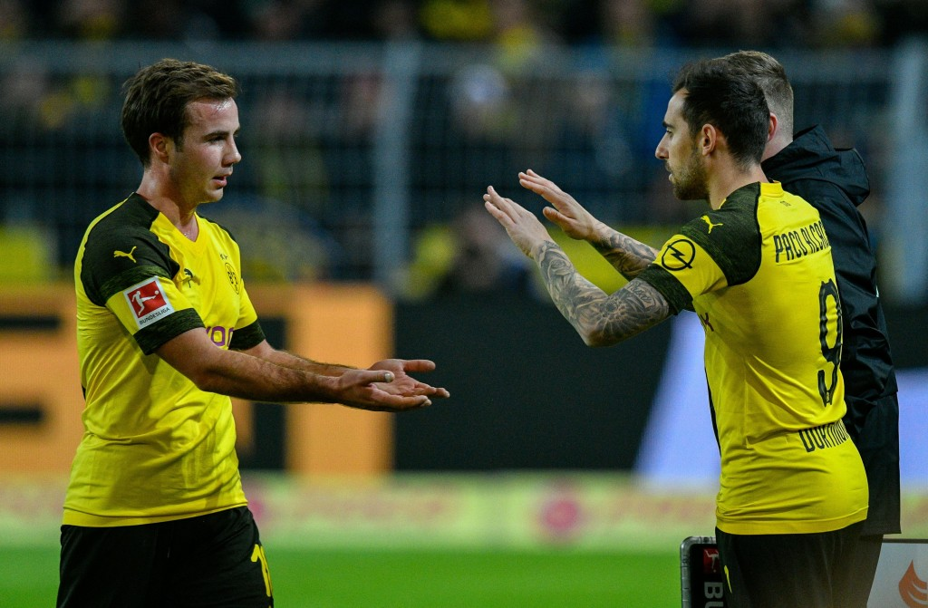 Dortmund's midfielder Mario Goetze and Dortmund's midfielder Alcacer Paco celebrate after scoring during the German first division Bundesliga football match between Borussia Dortmund and SC Freiburg in Dortmund, western Germany on December 1, 2018. (Photo by SASCHA SCHUERMANN / AFP) / RESTRICTIONS: DFL REGULATIONS PROHIBIT ANY USE OF PHOTOGRAPHS AS IMAGE SEQUENCES AND/OR QUASI-VIDEO (Photo credit should read SASCHA SCHUERMANN/AFP/Getty Images)