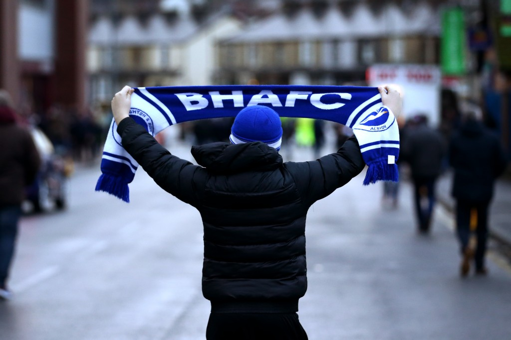 BURNLEY, ENGLAND - DECEMBER 08: A Brighton and Hove Albion fan holds up a scarf prior to the Premier League match between Burnley FC and Brighton & Hove Albion at Turf Moor on December 8, 2018 in Burnley, United Kingdom. (Photo by Jan Kruger/Getty Images)
