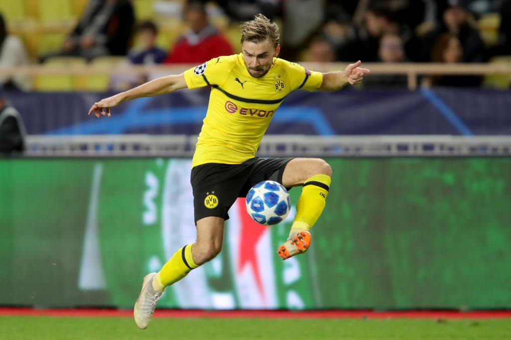 MONACO - DECEMBER 11: Marcel Schmelzer of Dortmund runs with the ball during the UEFA Champions League Group A match between AS Monaco and Borussia Dortmund at Stade Louis II on December 11, 2018 in Monaco, Monaco. (Photo by Alexander Hassenstein/Bongarts/Getty Images)