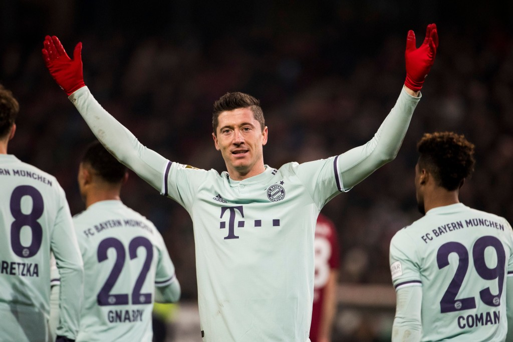 Bayern Munich's Polish forward Robert Lewandowski celebrates scoring his team's 4th goal during the German first division Bundesliga football match Hannover 96 v Bayern Munich at the HDI arena in Hanover, central Germany on December 15, 2018. (Photo by Odd ANDERSEN / AFP) / DFL REGULATIONS PROHIBIT ANY USE OF PHOTOGRAPHS AS IMAGE SEQUENCES AND/OR QUASI-VIDEO (Photo credit should read ODD ANDERSEN/AFP/Getty Images)