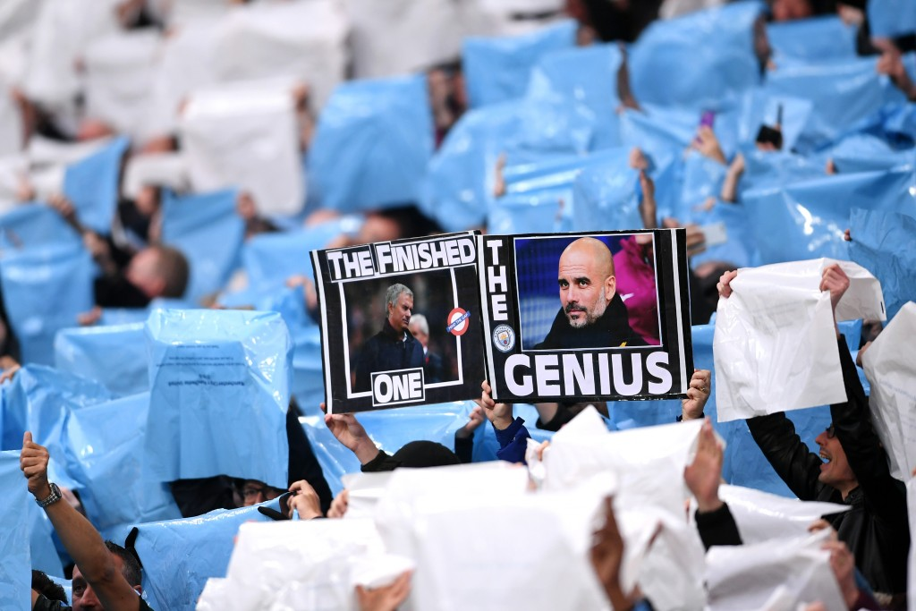 A banner that speaks volumes about Mourinho's current predicament, and Pep Guardiola's continued success. (Photo by Laurence Griffiths/Getty Images)