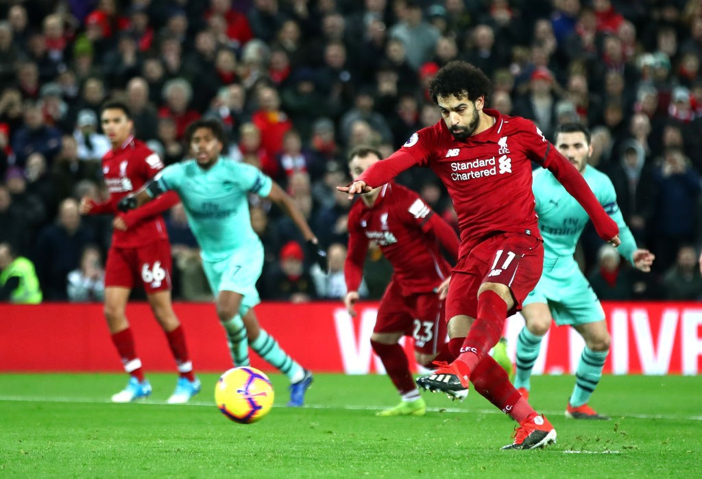 Mo Salah scores the penalty to put Liverpool 4-1 ahead against Arsenal. (Photo courtesy: AFP/Getty)