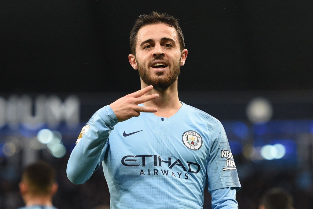 Manchester City's Portuguese midfielder Bernardo Silva celebrates scoring the opening goal during the English Premier League football match between Manchester City and Bournemouth at the Etihad Stadium in Manchester, north west England, on December 1, 2018. (Photo by Oli SCARFF / AFP) / RESTRICTED TO EDITORIAL USE. No use with unauthorized audio, video, data, fixture lists, club/league logos or 'live' services. Online in-match use limited to 120 images. An additional 40 images may be used in extra time. No video emulation. Social media in-match use limited to 120 images. An additional 40 images may be used in extra time. No use in betting publications, games or single club/league/player publications. / (Photo credit should read OLI SCARFF/AFP/Getty Images)