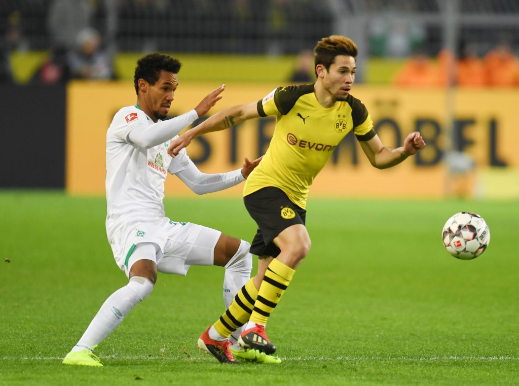 Dortmund's Portuguese defender Raphael Guerreiro and Bremen's Czech defender Theodor Gebre Selassie vie for the ball during the German first division Bundesliga football match Borussia Dortmund vs Werder Bremen in Dortmund, western Germany, on December 15, 2018. (Photo by Patrik STOLLARZ / AFP) / RESTRICTIONS: DFL REGULATIONS PROHIBIT ANY USE OF PHOTOGRAPHS AS IMAGE SEQUENCES AND/OR QUASI-VIDEO (Photo credit should read PATRIK STOLLARZ/AFP/Getty Images)