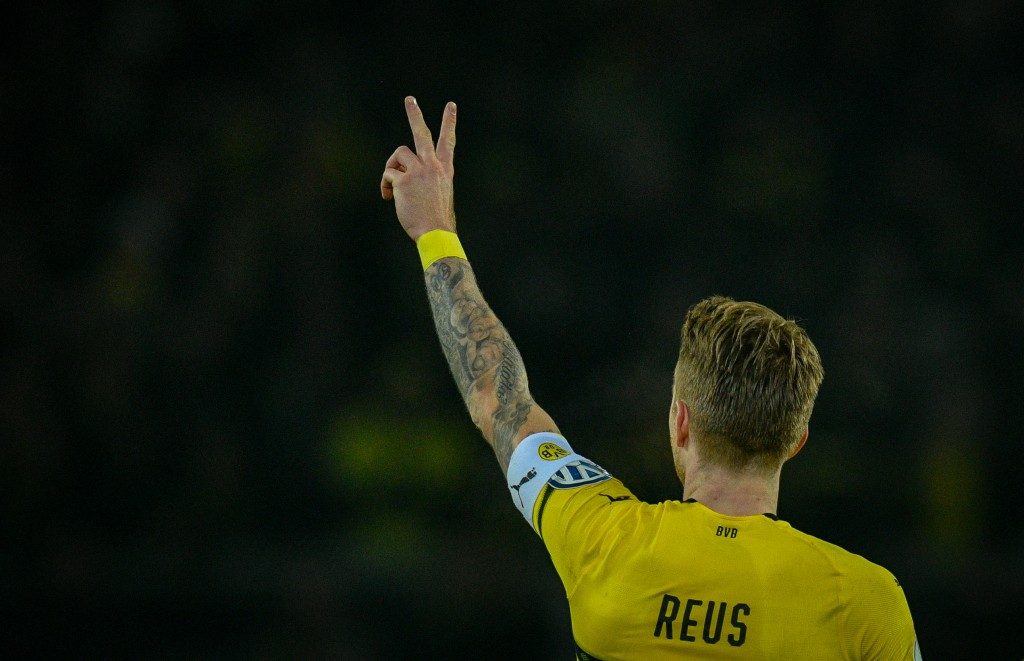 Dortmund's forward Marco Reus celebrate scoring the 1-1 equalizer during the German Cup (DFB Pokal) last 16 football match BVB Borussia Dortmund v Werder Bremen in Dortmund, western Germany on February 5, 2019. (Photo by SASCHA SCHUERMANN / AFP) / DFB REGULATIONS PROHIBIT ANY USE OF PHOTOGRAPHS AS IMAGE SEQUENCES AND QUASI-VIDEO. (Photo credit should read SASCHA SCHUERMANN/AFP/Getty Images)