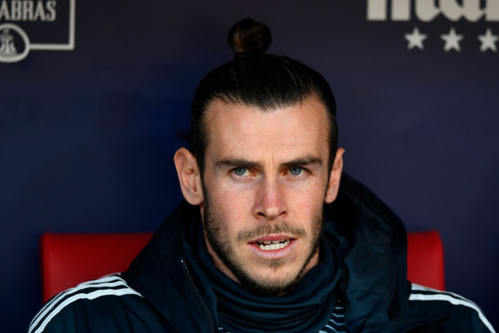 Bale has spent a lot of time on the bench and the sidelines this term. (Photo by Gabriel Bouys/AFP/Getty Images)