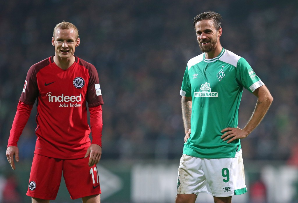 BREMEN, GERMANY - JANUARY 26: (L-R) Sebastian Rode of Eintracht Frankfurt and Martin Harnik of Werder Bremen talk to each other during the Bundesliga match between SV Werder Bremen and Eintracht Frankfurt at Weserstadion on January 26, 2019 in Bremen, Germany. (Photo by Cathrin Mueller/Bongarts/Getty Images)