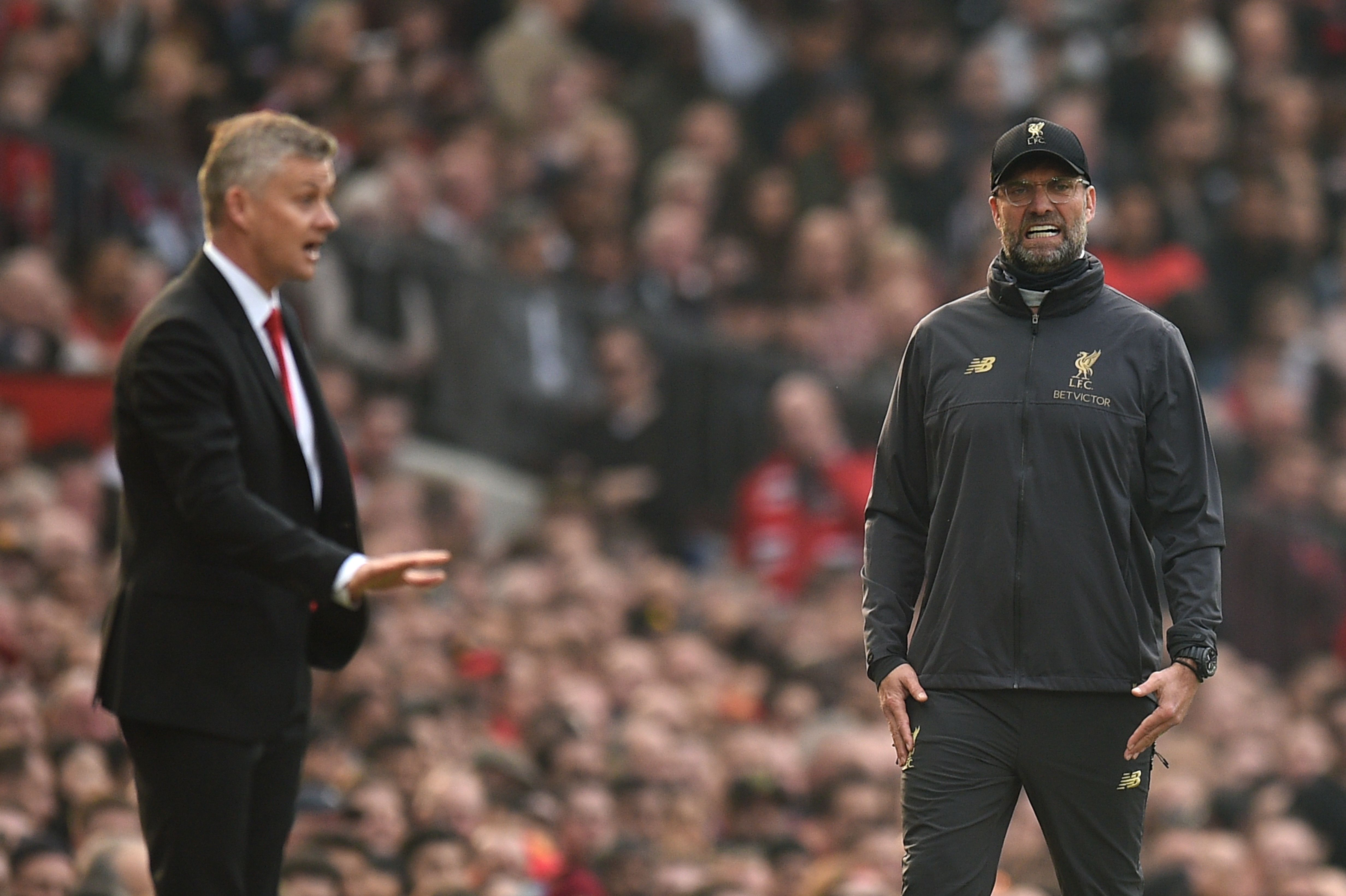 Solskjaer and Klopp will be aiming for the league title (Photo by OLI SCARFF/AFP/Getty Images)