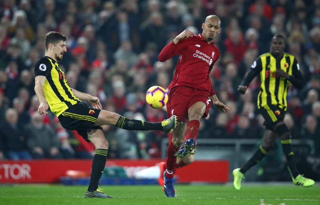 LIVERPOOL, ENGLAND - FEBRUARY 27: Craig Cathcart of Watford battles for possession with Fabinho of Liverpool during the Premier League match between Liverpool FC and Watford FC at Anfield on February 27, 2019 in Liverpool, United Kingdom. (Photo by Clive Brunskill/Getty Images)