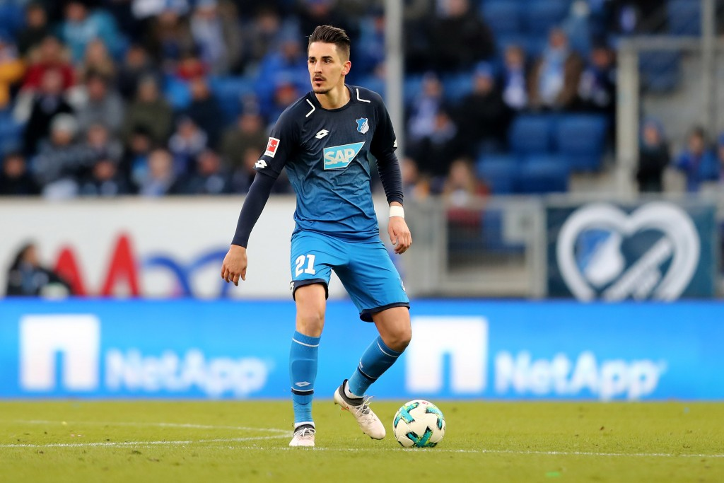 SINSHEIM, GERMANY - FEBRUARY 24: Benjamin Huebner of Hoffenheim runs with the ball during the Bundesliga match between TSG 1899 Hoffenheim and Sport-Club Freiburg at Wirsol Rhein-Neckar-Arena on February 24, 2018 in Sinsheim, Germany. The match between Hoffenheim and Freiburg ended 1-1. (Photo by Christof Koepsel/Bongarts/Getty Images)