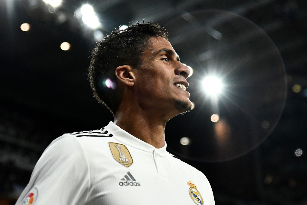 Real Madrid's French defender Raphael Varane smiles during the Spanish league football match between Real Madrid and Valencia at the Santiago Bernabeu stadium in Madrid on December 1, 2018. (Photo by OSCAR DEL POZO / AFP) (Photo credit should read OSCAR DEL POZO/AFP/Getty Images)