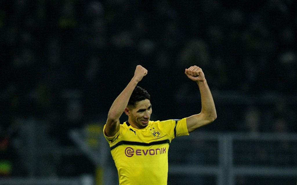 Dortmund's defender Achraf Hakimi celebrates scoring the 3-2 goal during the German Cup (DFB Pokal) last 16 football match BVB Borussia Dortmund v Werder Bremen in Dortmund, western Germany on February 5, 2019. (Photo by SASCHA SCHUERMANN / AFP) / DFB REGULATIONS PROHIBIT ANY USE OF PHOTOGRAPHS AS IMAGE SEQUENCES AND QUASI-VIDEO. (Photo credit should read SASCHA SCHUERMANN/AFP/Getty Images)