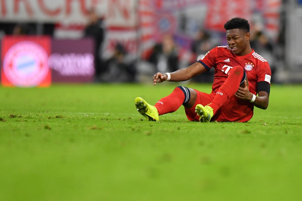 MUNICH, GERMANY - FEBRUARY 09: David Alaba of Bayern Munich holds his thigh during the Bundesliga match between FC Bayern Muenchen and FC Schalke 04 at Allianz Arena on February 09, 2019 in Munich, Germany. (Photo by Sebastian Widmann/Bongarts/Getty Images)