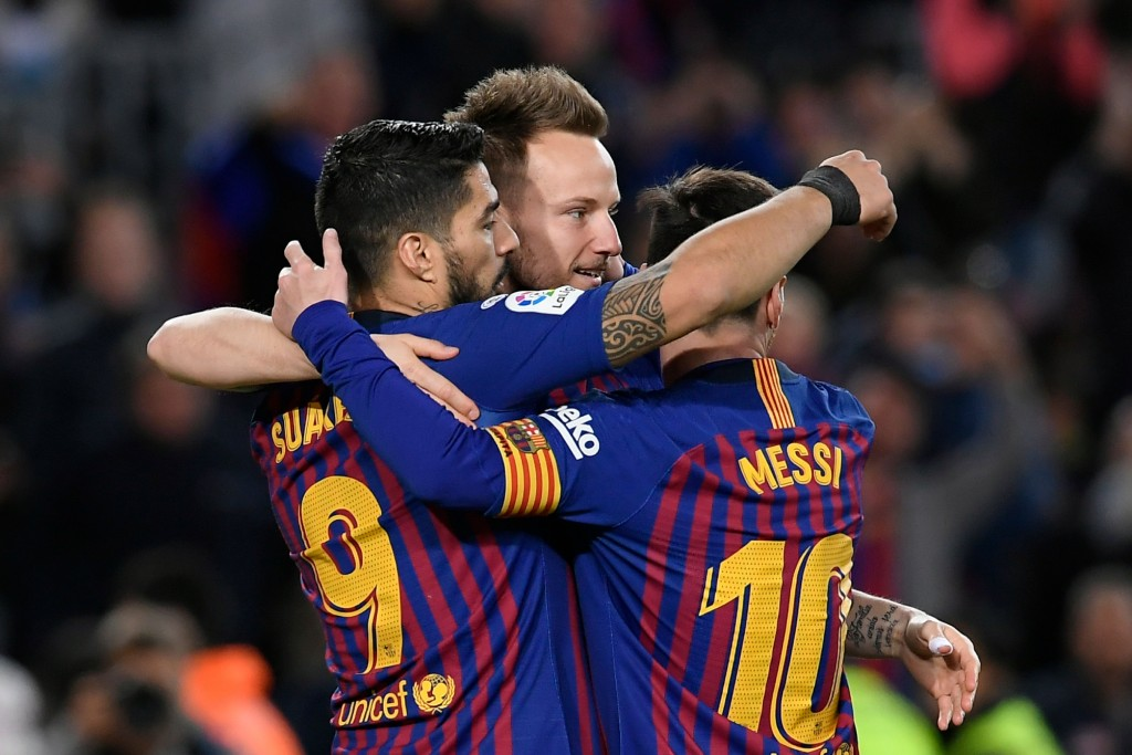 Messi, Suarez on target for Barcelona (Photo by LLUIS GENE/AFP/Getty Images)