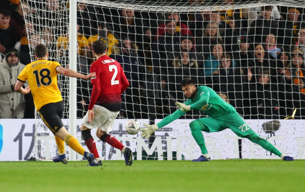 Romero should have done better to deny Diogo Jota, but was still the best performer for Manchester United. (Photo by Catherine Ivill/Getty Images)