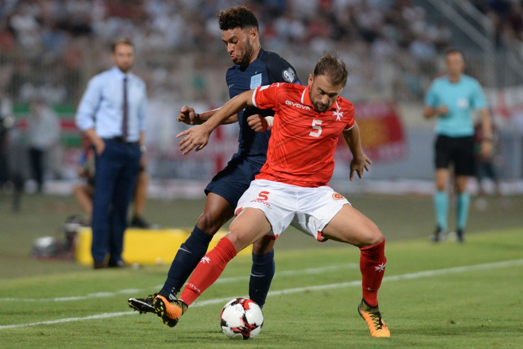 England' Alex Oxlade-Chamberlain (L) vies with Malta's Andrei Agius during the 2018 FIFA World Cup qualifying football match Malta vs England at the National Stadium in Malta's Ta' Qali village, on September 1, 2017. / AFP PHOTO / Matthew Mirabelli / Malta OUT (Photo credit should read MATTHEW MIRABELLI/AFP/Getty Images)