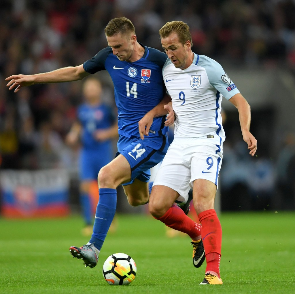 LONDON, ENGLAND - SEPTEMBER 04: Harry Kane of England holds off Milan Skriniar of Slovakia during the FIFA 2018 World Cup Qualifier between England and Slovakia at Wembley Stadium on September 4, 2017 in London, England. (Photo by Mike Hewitt/Getty Images)