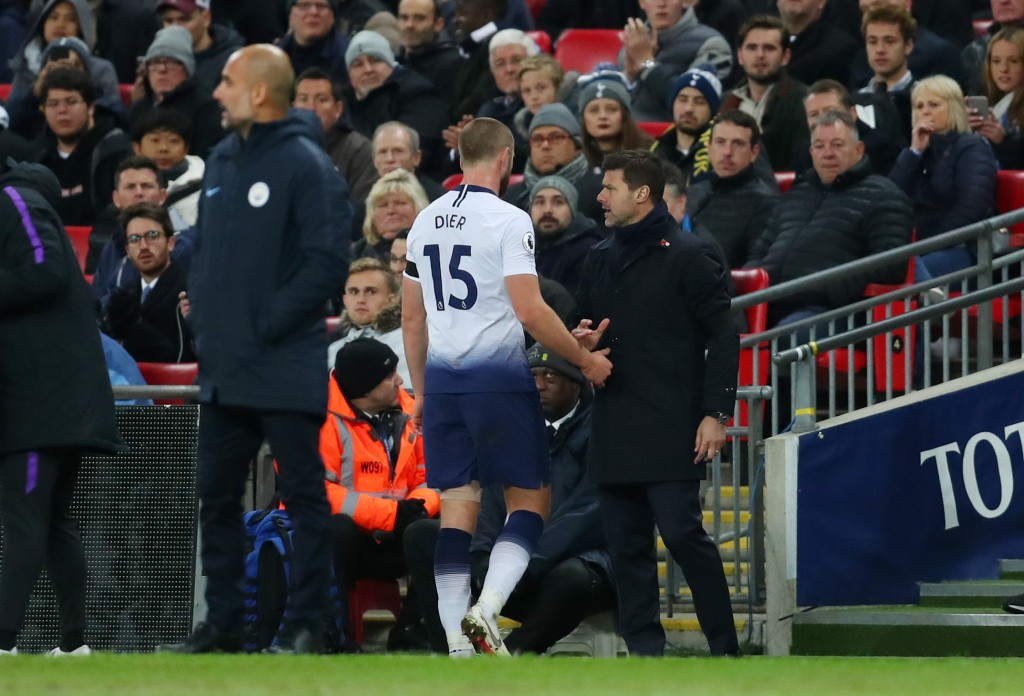 LONDON, ENGLAND - OCTOBER 29: Eric Dier of Tottenham Hotspur shakes hands with Mauricio Pochettino, Manager of Tottenham Hotspur after being substituted off during the Premier League match between Tottenham Hotspur and Manchester City at Wembley Stadium on October 29, 2018 in London, United Kingdom. (Photo by Catherine Ivill/Getty Images)