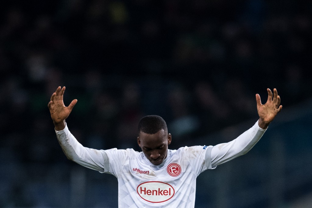 HANOVER, GERMANY - DECEMBER 22: Dodi Lukebakio of Düsseldorf celebrates the win of the Bundesliga match between Hannover 96 and Fortuna Duesseldorf at HDI-Arena on December 22, 2018 in Hanover, Germany. (Photo by Lukas Schulze/Bongarts/Getty Images)