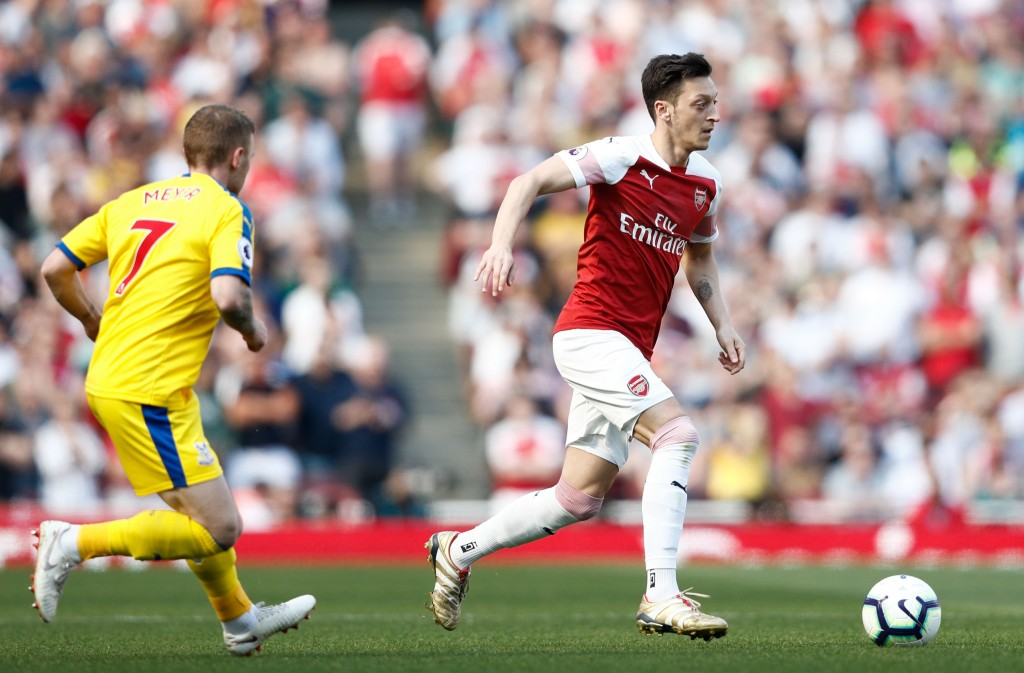 Ozil was impressive. (Photo by Adrian Dennis/AFP/Getty Images)